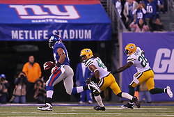 Dec 4, 2011; East Rutherford, NJ, USA; New York Giants tight end Travis Beckum (47) runs for a touchdown after catching a pass from New York Giants quarterback Eli Manning (10) during the first half at MetLife Stadium.