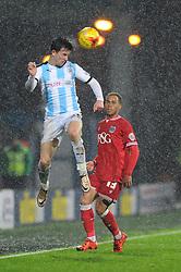 Ben Chilwell of Huddersfield Town wins a header - Mandatory byline: Dougie Allward/JMP - 12/12/2015 - Football - St John Smith's Stadium - Huddersfield, England - Huddersfield Town v Bristol City - Sky Bet Championship