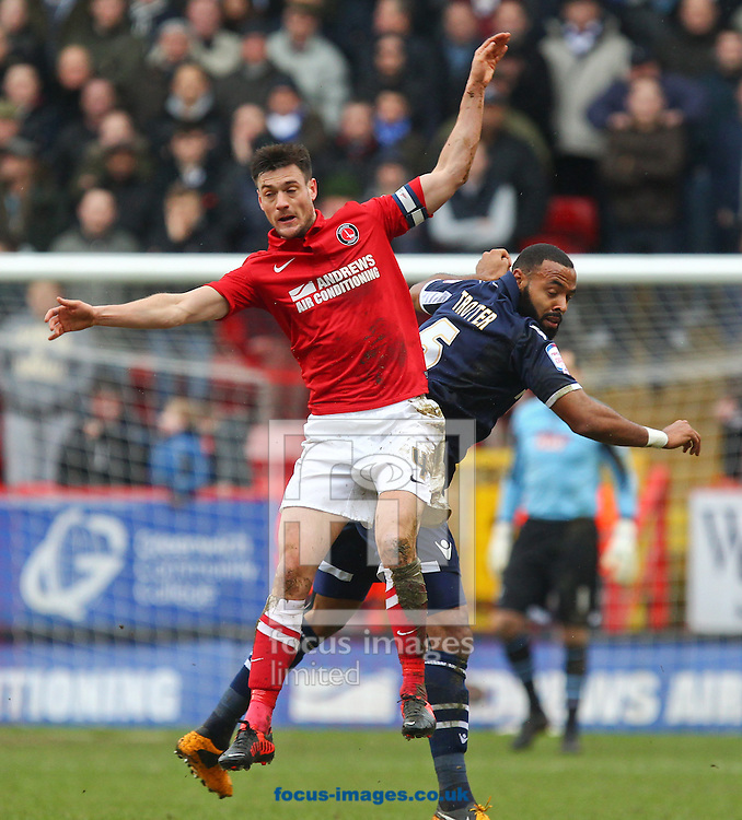 Picture by John  Rainford/Focus Images Ltd +44 7506 538356.16/03/2013.Johnnie Jackson of Charlton Athletic and Liam Trotter of Millwall during the npower Championship match at The Valley, London.