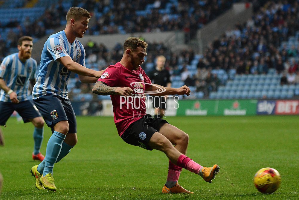 Coventry City defender Aaron Phillips tracks Peterborough United midfielder Jon Taylor during the Sky Bet League 1 match between Coventry City and Peterborough United at the Ricoh Arena, Coventry, England on 31 October 2015. Photo by Alan Franklin.