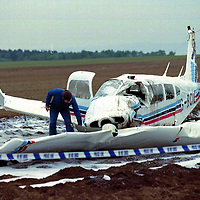 Air crash...27.5.99.<br />A crash investigators at the scene of the air crash near Scone Airfield.<br /><br />Picture Copyright:  John Lindsay / Perthshire Picture Agency.<br />Tel. office 01738 623350. mobile 07775 852112