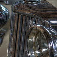 Close up of classic car, Jaguar SS with chrome lights and grill