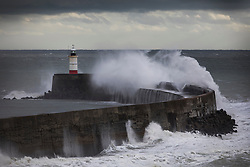 © Licensed to London News Pictures. 20/11/2016. Newhaven, UK. Storm Angus whips up the sea at Newhaven lighthouse. The south east has experienced winds of up to 80 miles per hour as the first named storm of the season hits. Photo credit: Peter Macdiarmid/LNP
