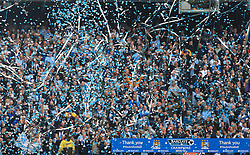 © Licensed to London News Pictures. London, UK. 11/05/2014. London, UK.  Manchester City FC supporters celebrate after  winning the Barclays Premier League  at the Etihad Stadium.Photo credit: LNP