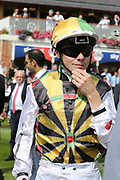 Jockey JAMIE SPENCER in dartboard racing colours  during the Ebor Festival at York Racecourse, York, United Kingdom on 24 August 2019.