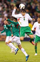 February 24, 2010; San Francisco, CA, USA;  Bolivia defender Marvin Bejarano (4) heads the ball during the second half against Mexico at Candlestick Park. Mexico defeated Bolivia 5-0.
