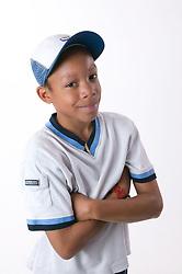 Portrait of a teenaged boy wearing a baseball cap,
