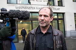 © Licensed to London News Pictures. 14/02/2018. London, UK. James (Jim) Matthews leaves Westminster Magistrates Court after appearing charged with one count of 'attending a place used for terrorist training', under section 8 of the Terrorism Act 2006. The former British Army soldier fought with Kurdish forces - the YPG - against ISIS in Syria. Photo credit : Tom Nicholson/LNP