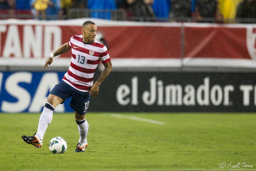 USA Men's National Team midfielder JERMAINE JONES (13) during the Antigua & Barbuda vs USA Men's National Team  semifinal round of 2014 FIFA World Cup qualifier at Raymond James Stadium in Tampa, Fl. .