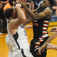 Hoggard's Patrick Morrison and New Hanover's Lawrence Williams struggle for a loose ball Friday December 12, 2014 at Hoggard High School in Wilmington, N.C. (Jason A. Frizzelle)