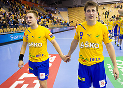 Gasper Marguc of Celje and David Razgor of Celje  celebrate after the handball match between RK Celje Pivovarna Lasko and IK Savehof (SWE) in 3rd Round of Group B of EHF Champions League 2012/13 on October 13, 2012 in Arena Zlatorog, Celje, Slovenia. (Photo By Vid Ponikvar / Sportida)