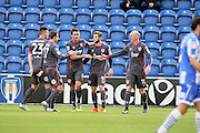 Morecambe FC forward Tom Barkhuizen (9) celebrates with team mates after opening the scoring during the EFL Sky Bet League 2 match between Colchester United and Morecambe at the Weston Homes Community Stadium, Colchester, England on 22 October 2016. Photo by Nigel Cole.