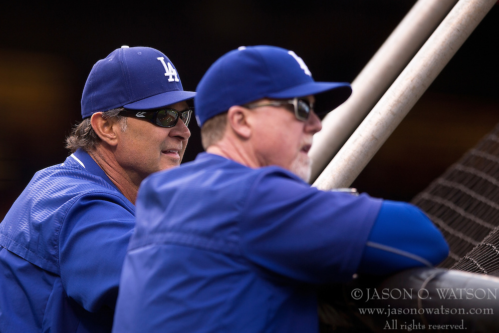 SAN FRANCISCO, CA - MAY 20:  Don Mattingly #8 of the Los Angeles Dodgers and batting coach Mark McGwire #25 look on during batting practice before the game against the San Francisco Giants at AT&T Park on May 20, 2015 in San Francisco, California.  The San Francisco Giants defeated the Los Angeles Dodgers 4-0. (Photo by Jason O. Watson/Getty Images) *** Local Caption *** Don Mattingly; Mark McGwire