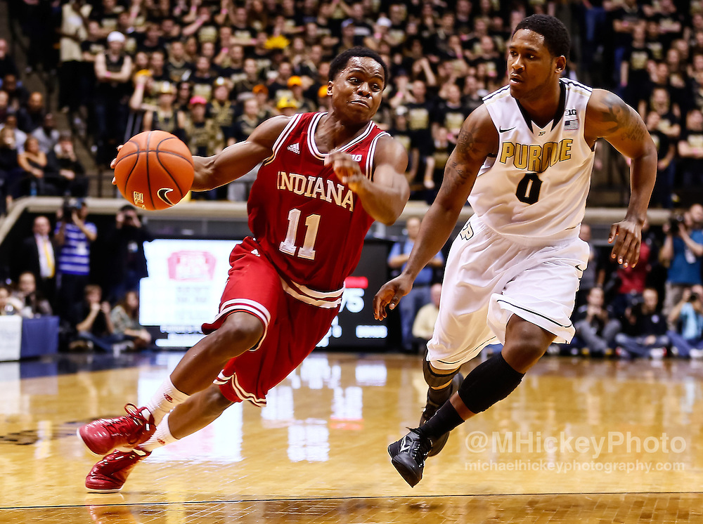 WEST LAFAYETTE, IN - JANUARY 30: Kevin Ferrell #11 of the Indiana Hoosiers dribbles the ball against Terone Johnson #0 of the Purdue Boilermakers at Mackey Arena on January 30, 2013 in West Lafayette, Indiana. Indiana defeated Purdue 97-60. (Photo by Michael Hickey/Getty Images) *** Local Caption *** Kevin Ferrell; Terone Johnson
