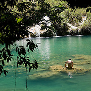 The freshwater pools of Semuc Champey, where turquoise waters seep up from an underground water system and form an oasis of sorts in the jungle.  Lanquin, Guatemala, July 2009.  (Photo/William Byrne Drumm)