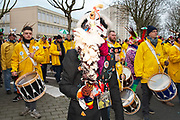 France, Dunkerque, 25 February 2017. Carnaval de Dunkerque, a Carnavaleux in Cletche parades  with the  band Base Ville.