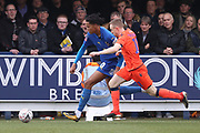 AFC Wimbledon defender Toby Sibbick (20) battles for possession with Millwall midfielder Shane Ferguson (11) during the The FA Cup 5th round match between AFC Wimbledon and Millwall at the Cherry Red Records Stadium, Kingston, England on 16 February 2019.