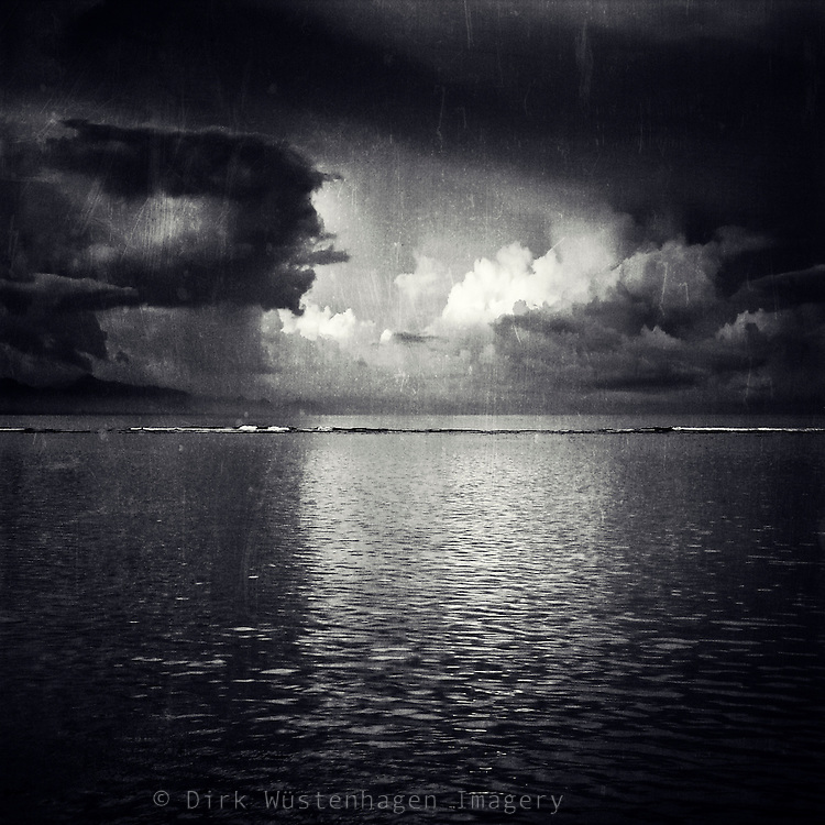 Thunderstorm over the Indic Ocean with the light of the rising sun reflecting on clouds. <br />