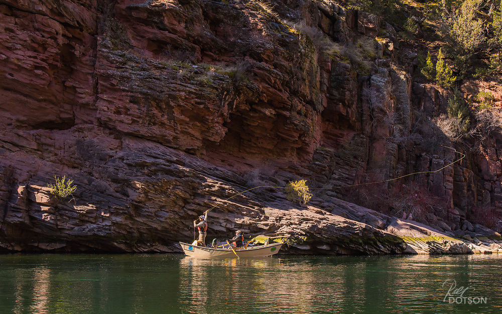 Casting to undercut sandstone cliffs, an angler on the Green River probes for the bigger browns.