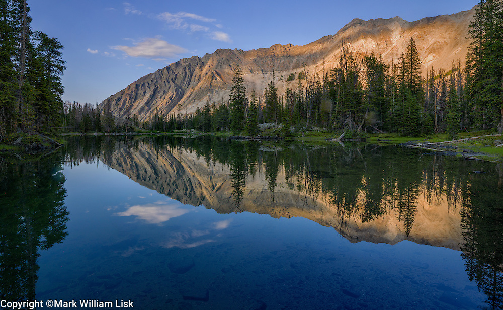 The Chinesse Wall, 11,238 feet, reflects into Ocalkens Lake in the White Cloud Range.