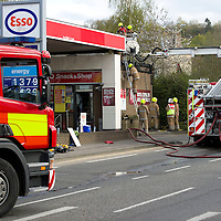 Firefighters and Police at the Esso Petrol Station on Edinburgh Road in Perth after a fire broke out in the roof of the shop, the fire was extinguished before spreading to the petrol forecourt, the fire was treated as a major incident with the main Edinburgh Road closed....15.04.12<br /> Picture by Graeme Hart.<br /> Copyright Perthshire Picture Agency<br /> Tel: 01738 623350  Mobile: 07990 594431