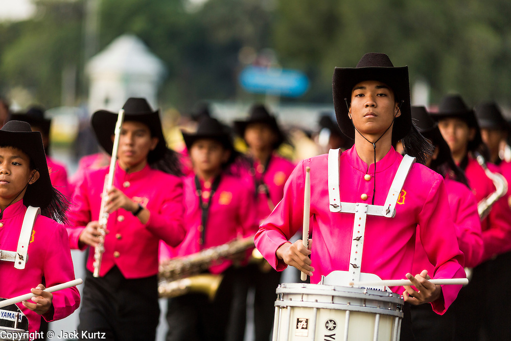 05 DECEMBER 2013 - BANGKOK, THAILAND: A high school marching band participates in a parade for the King of Thailand. Thais observed the 86th birthday of Bhumibol Adulyadej, the King of Thailand, their revered King on Thursday. They held candlelight services throughout the country. The political protests that have gripped Bangkok were on hold for the day, although protestors did hold their own observances of the holiday. Thousands of people attended the government celebration of the day on Sanam Luang, the large public space next to the Grand Palace in Bangkok.     PHOTO BY JACK KURTZ