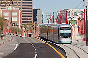 28 DECEMBER 2008 -- PHOENIX, AZ: A Metro light rail train pulls into a station in central Phoenix Sunday. The new Metro Light Rail is 20 miles long and cost $1.4 billion dollars. Construction was funded by local, state and federal monies. The trains will operate on one line through Phoenix and the suburban communities of Tempe and Mesa. The trains started running Saturday, Dec 27, 2008 and will be free until Jan. 1, 2009. The regular fare will be $1.25 for one ride or $2.50 for an all day pass.  Photo by Jack Kurtz / ZUMA Press