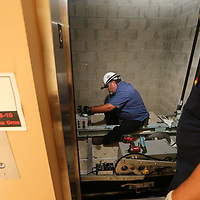 Forest Goldberg, left,and A.J. Sanders begin installing new hardware to the two elevators at the Tupelo City Hall on Wednesday. The work should be completed to the elevators in six weeks.