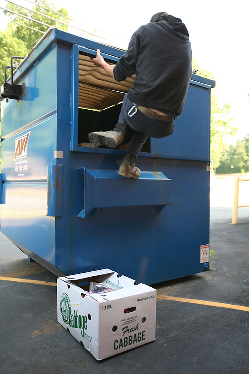 Siler City, NC - May 13: Dumpster-diving with Trace R. in Siler City. (Photo by Logan Mock-Bunting)