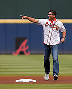 ATLANTA, GA - OCTOBER 2:  Former Atlanta Braves catcher Javy Lopez runs on the field during pre-game ceremonies to honor the last game at Turner Field during the game between the Detroit Tigers and the Atlanta Braves on Sunday, October 2, 2016 in Atlanta, Georgia. (Photo by Mike Zarrilli/MLB Photos via Getty Images) *** Local Caption ***