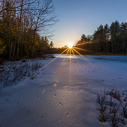 Late winter sunset on the Bellamy River in Madbury, New Hampshire.