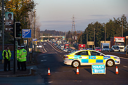 © Licensed to London News Pictures . 25/10/2016 . Salford , UK . Road closed to traffic in front of the fatal crash scene on the westbound carriageway of the A580 East Lancs Road at the junction with Moorside Road in Salford , where a man in his 70s died following a collision involving two Nisson Primeras and another vehicle , this morning (Tuesday 25th October 2016) .  Photo credit : Joel Goodman/LNP
