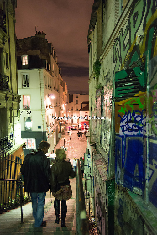 France. Paris 18th; people on Montmartre stairs, Rue drevet at night / Rue Drevet, les excaliers de Montmartre la nuit