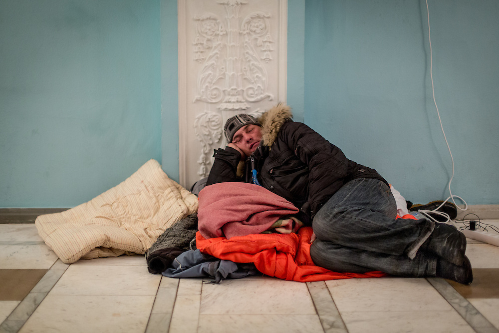 A man takes a nap, on the floor of the Center of Ukrainian Culture, occupied by the protesters.