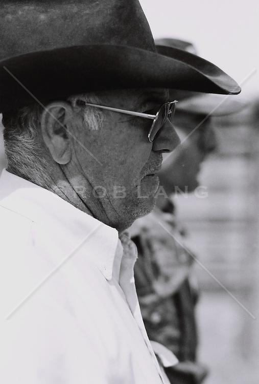 Mature man wearing hat, side view