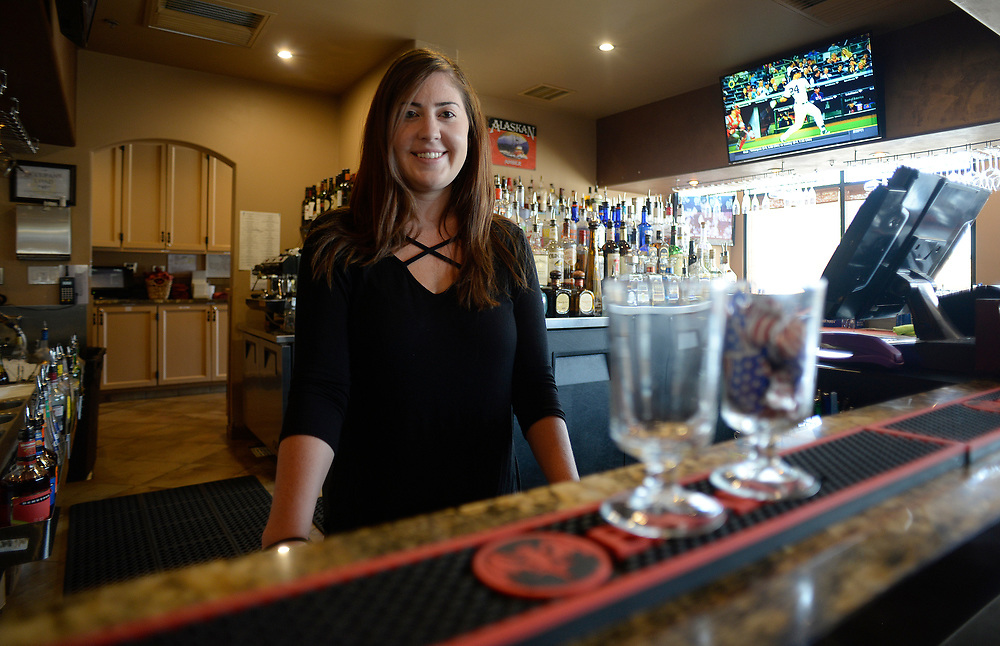 apl071817b/BUSINESS/pierre-louis/JOURNAL 071817<br /> Holly  Maurer,, a bartender at Nick and Jimmy's is a beneficiary of the work study program offered by the restaurant  .Photographed on Tuesday July  18,  2017. .Adolphe Pierre-Louis/JOURNAL