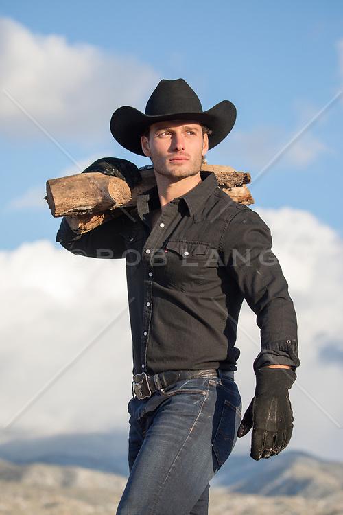 Chiseled cowboy carrying wood
