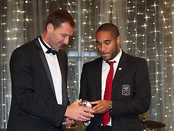 CARDIFF, WALES - Monday, October 8, 2012: Aberystwyth Town's Aneurin Thomas receives the Welsh Premier League Clubman of the Year award from Wales' captain Ashley Williams during the FAW Player of the Year Awards Dinner at the National Museum Cardiff. (Pic by David Rawcliffe/Propaganda)