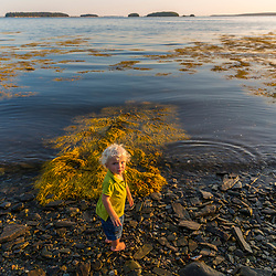 A young boy plays on East Gosling Island in Casco Bay, Harpswell, Maine.