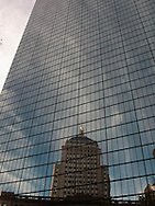 United States. Boston city center reflection on a mirror tower, The Hancock tower
