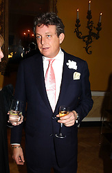 LORD VALENTINE CECIL at a private view of jewellery designed and made by Luis Miguel Howard held at 30 Pavillion Road, London on 27th October 2004.<br />