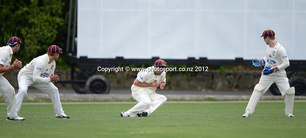 Brad Wilson takes a catch at 1st slip to dismiss Gareth Hopkins off the bowling of Arnel. Plunket Shield Cricket, Auckland Aces v Northern Knights at Eden Park outer oval. Sunday 11 November 2012. Photo: Andrew Cornaga/Photosport.co.nz