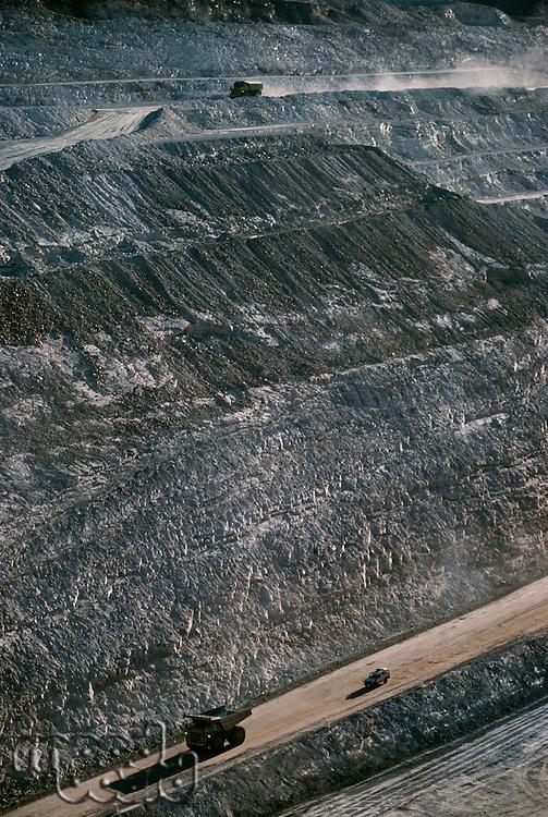 Earth moving trucks open cut gold mine Telfer Western Australia