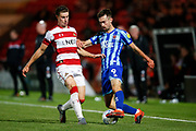 Ben Sheaf of Doncaster Rovers challenges Ryan Hardie of Blackpool F.C. during the EFL Sky Bet League 1 match between Doncaster Rovers and Blackpool at the Keepmoat Stadium, Doncaster, England on 17 September 2019.