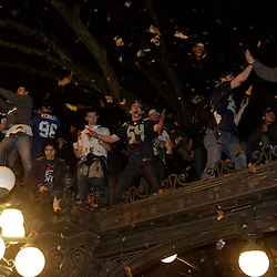 Seattle Seahawks celebrate on top of an awning after their team won Super Bowl XLVIII in Seattle, Washington February 2, 2014. The Seahawks beat the Denver Broncos 43-8 for their first NFL championship Sunday in East Rutherford, New Jersey.  REUTERS/Jason Redmond  (UNITED STATES)