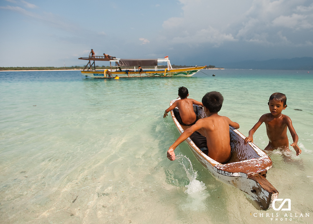 The children on Gili Islands strip off their clothes after school and spend hours playing in the perfect island waters. Gili Trawangan, Indonesia