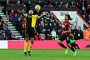 Troy Deeney (9) of Watford controls the ball as Nathan Ake (5) of AFC Bournemouth closes in during the Premier League match between Bournemouth and Watford at the Vitality Stadium, Bournemouth, England on 12 January 2020.