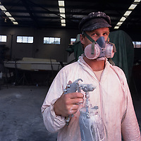 Australia, New South Wales, Sydney, (MR) Portrait of Bruce Trinock wearing protective mask while working at the Sydney Shipbuilding Yard
