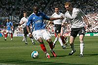 Photo: Steve Bond. <br />Derby County v Portsmouth. Barclays Premiership. 11/08/2007. John Utaka (L) attacks defender Stephen Pearson (R)