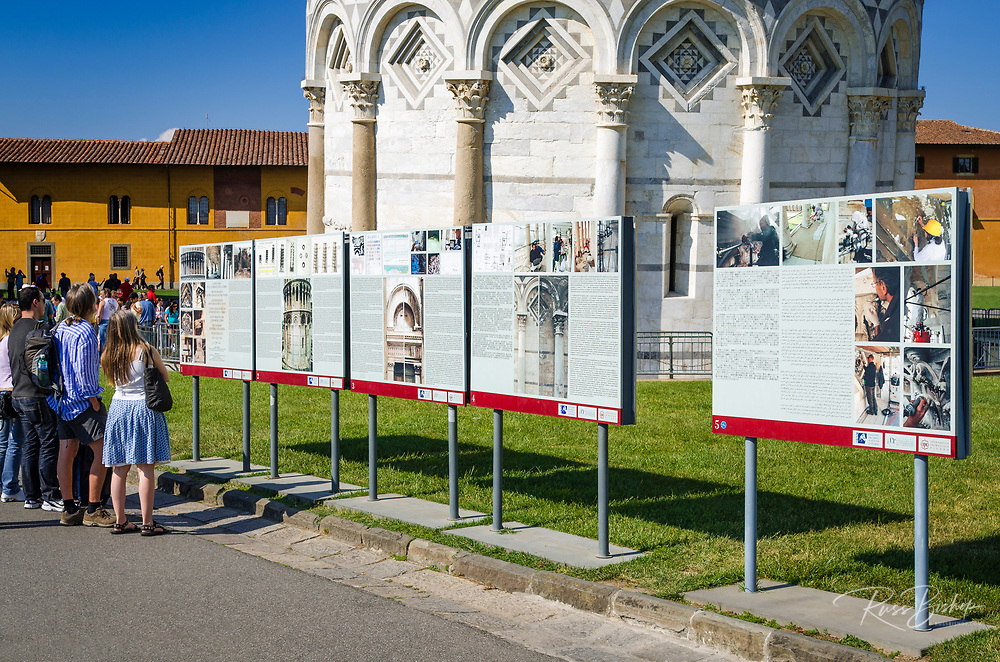 Interpretive signs detailing restoration at the Leaning Tower of Pisa, Pisa, Tuscany, Italy